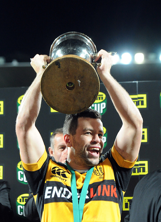 Taranaki's James Marshall with the trophy after his team defeated the Tasman Makos in the ITM Cup Rugby Premiership final match at Yarrow Stadium, New Plymouth, New Zealand, Saturday, October 25, 2014. Credit:SNPA / Ross Setford