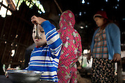 The youngest son of Ko Aung Mgo having breakfast while the family is making the palm sugar.<br />