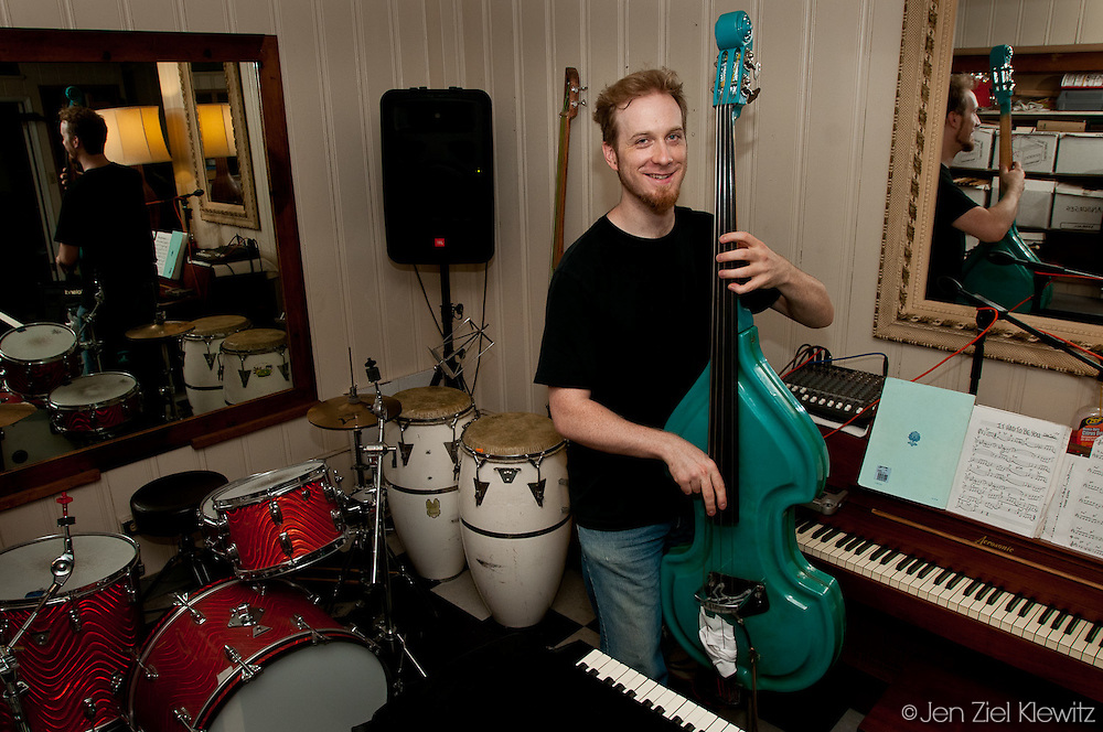 Musician David Goodwin plays his favorite bass at his home in Los Angeles California, on August 11, 2009. Photo by Jen Klewitz