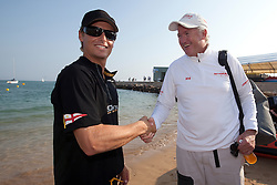 Peter Gilmour and Torvar Mirsky shake hands after the finals of the Portimao Portugal Match Cup 2010. World Match Racing Tour. Portimao, Portugal. 27 June 2010. Photo: Gareth Cooke/Subzero Images