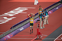 Oscar Pistorius of South Africa looks on after his teammate failed to finish during the 4X100 during track and field at the Olympic Stadium during day 13 of the London Olympic Games in London, England, United Kingdom on August 9, 2012..(Jed Jacobsohn/for The New York Times)..
