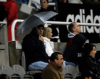 Photo: Jed Wee.<br /> Newcastle United v Portsmouth. Carling Cup. 25/10/2006.<br /> <br /> Newcastle fans watch the game played out under awful weather conditions.
