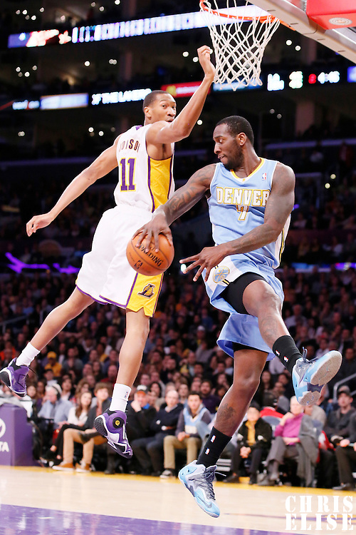 05 January 2014: Denver Nuggets power forward J.J. Hickson (7) passes the ball while in the air over Los Angeles Lakers shooting guard Wesley Johnson (11) during the Denver Nuggets  137-115 victory over the Los Angeles Lakers at the Staples Center, Los Angeles, California, USA.