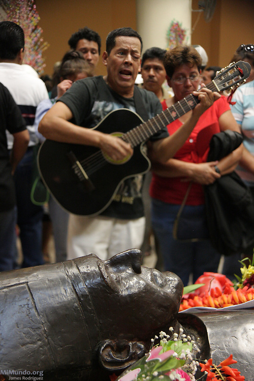 A man plays guitar at the crypt of Monsignor Oscar Arnulfo Romero, located under San Salvador's Cathedral, on the 30th anniversary of the assassination of the former Archbishop. On March 24th, 1980, Monsignor Romero was gunned down by a professional sniper while giving a mass in the chapel of the Divina Providencia Hospital. Monsignor Romero had become a recognized critic of violence and injustice and was therefore perceived as a dangerous enemy by certain military and right wing groups in El Salvador. San Salvador, El Salvador. March 24, 2010.