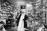 """PALERMO, ITALY - 18 JANUARY 2019: Bhuiyan Anwar Hosen (63), from Bangladesh, poses for a portrait in his shop in the Ballarò market<br /> in Palermo, Italy, on January 18th 2019.<br /> <br /> In May 2016 of this year, ten mafia-linked criminals with ties to the Rubino family were arrested for harassing migrants and demanding payment of """"pizzo""""(protection) money. Addiopizzo, an anti-mafia movement founded by university graduates in 2004, supported the Bangladeshi stallholders in getting these mafiosi arrested.<br /> <br /> The historic market Ballarò of Palermo, in the neighbourhood known as Albergheria, is the oldest and biggest among the markets of the city.<br /> For about half a century, after World War II, Ballarò was increasingly depopulated as families moved to airier suburbs. Today there are over 14 ethnicities in Ballarò and more than 25 languages spoken: migrant communities, students, professionals, historic merchants and new entrepreneurs coexist."""