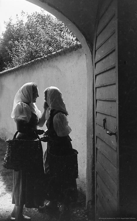 Miss Lindinger, Miss Grell talking, Molln, Austria, 1937