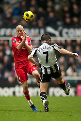 NEWCASTLE, ENGLAND - Saturday, December 11, 2010: Liverpool's Paul Konchesky and Newcastle United's Joey Barton during the Premiership match at St James' Park. (Photo by: David Rawcliffe/Propaganda)