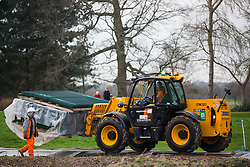 Denham, UK. 5 February, 2020. A JCB forklift vehicle transports fencing across a temporary roadway at Buckinghamshire Golf Club in the Colne Valley for works planned in conjunction with the HS2 high-speed rail link including the felling of mature trees in a nature reserve on the other side of the river Colne and the construction of a Bailey bridge across the river. Environmental activists are occupying trees in Denham Country Park in an attempt to prevent or hinder the work.
