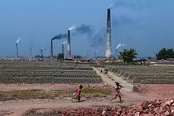 November 21, 2018 - Dhaka, Bangladesh - Child works in the brickfield in Dhaka, Bagladesh, on November 21, 2018. (Credit Image: © Kazi Salahuddin Razu/NurPhoto via ZUMA Press)