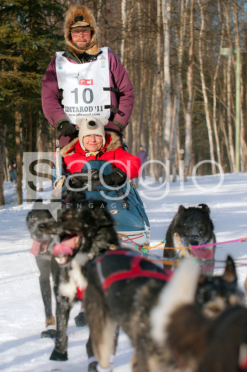 Musher Robert Bundtzen and Iditarider Ann Holt ride along the Chester Creek Trail during the 2011 Iditarod Ceremonial Start.