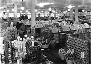 A  well-stocked grocery store in America in the 1920s.