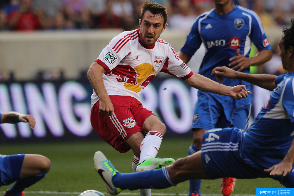 Eric Alexander, New York Red Bulls, weaves his way through the Montreal defense to score his sides first goal during the New York Red Bulls V Montreal Impact, Major League Soccer regular season match at Red Bull Arena, Harrison, New Jersey. USA. 13th July 2013. Photo Tim Clayton