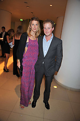 GUY PELLY and SUSANNA WARREN at the St.Martins Lane Hotel 10th year bash held on 9th September 2009.