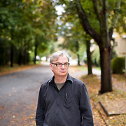 "October 7, 2013 - New Yor, NY : Playwright Richard Nelson, whose four-play cycle the ""Apple Family Plays"" are set in his hometown of Rhinebeck in the Hudson Valley, poses for a portrait on Monday morning on Center Street in Rhinebeck. The town and its various landmarks, including a home on Center Street (not visible), inspired the setting of the plays.    CREDIT: Karsten Moran for The New York Times"