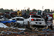 May 23, 2011- Damaged cars pile up in parking lots in Joplin, Missouri after a Tornado came through the town on Sunday, May 22, 2011. Credit: David Welker / TurfImages.com.