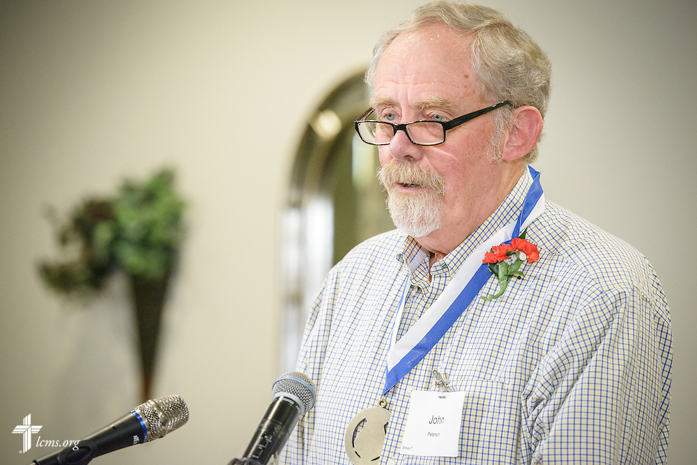 "The Rev. Dr. John Peterson, ""Christus in Mundo (""Christ in the World"") award recipient, speaks at the SPM Zion XVI Conference award banquet on Saturday, Sept. 17, 2016, at the National Shrine of Our Lady of the Snows in Belleville, Ill. LCMS Communications/Erik M. Lunsford"