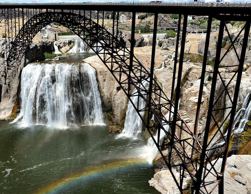 Twin Falls, Idaho Composite of Two Photos<br /> Two photos of Twin Falls, Idaho are The four-lane truss arched Perrine Bridge which was built in 1976 and is a popular BASE jumping location, and The Snake River cascading 212 feet over the Shosone Falls which is 900 feet wide, producing spectacular rainbows.