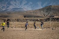 Locals playing soccer near Berrem Gorgem Midelt, Morocco.