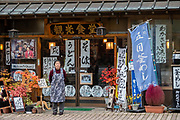 Restaurant front in Chuzenjiko Onsen, Nikko, Tochigi Prefecture, Japan. Lake Chuzenji (Chuzenjiko) is a scenic lake in the mountains above the town of Nikko. It's at the foot of Mount Nantai, Nikko's sacred volcano, whose eruption blocked the valley below, thereby creating Lake Chuzenji 20,000 years ago. Chuzenjiko's shores are mostly undeveloped and forested except at the eastern end where the growing hot spring town of Chuzenjiko Onsen was built. Chuzenjiko is especially beautiful in mid to late October, when the autumn colors reach their peak along the lake's shores and surrounding mountains. See panoramic views of Lake Chuzenji along the Chuzenjiko Skyline, an eight kilometer long former toll road accessible by bus or car, which also connects to scenic hiking trails.