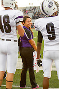 Student trainer Paige Derry stands ready toon the sidelines of a recent Cedar Ridge football game.  Photo taken September 27, 2013 at Hendrickson High School, Pflugerville, TX.  (LOURDES M. SHOAF/American-Statesman)