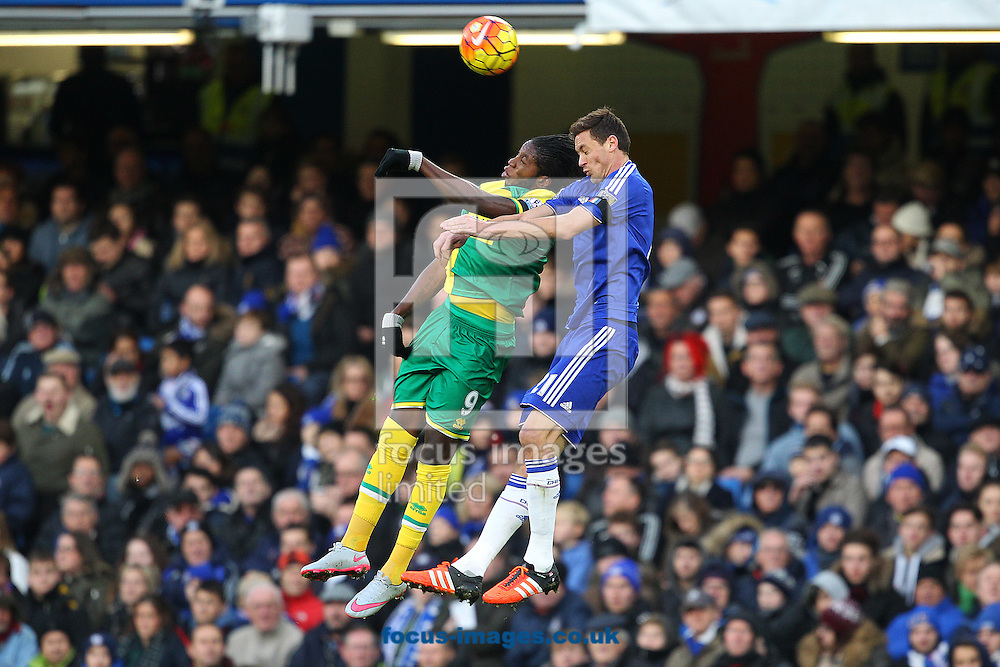 Dieumerci Mbokani of Norwich and Nemanja Matić of Chelsea in action during the Barclays Premier League match at Stamford Bridge, London<br /> Picture by Paul Chesterton/Focus Images Ltd +44 7904 640267<br /> 21/11/2015