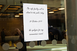 London, UK. 31 October, 2019. A notice indicating that the café at the offices housing ITV and Channel 4 in Gray's Inn Road is closed during a strike by low-paid migrant cleaners who work there outsourced via City & Essex and belonging to the United Voices of the World (UVW) trade union.
