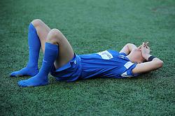 Bristol Academy's Ann-Marie Heatherson lies on the floor after losing the game - Photo mandatory by-line: Dougie Allward/JMP - Tel: Mobile: 07966 386802 29/09/2013 - SPORT - FOOTBALL - Halton Stadium - Widness - Liverpool Ladies V Bristol Academy WFC - Womens Super League - Title Decider
