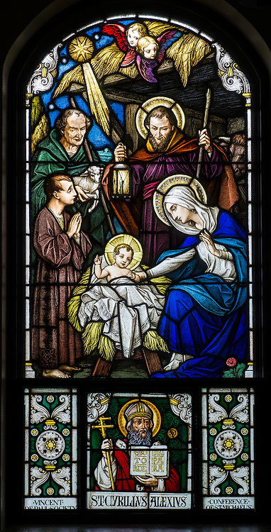 "A stained glass image depicts Jesus in a manger surrounded by his mother, Mary, Joseph and two shepherds. The stained glass window, inside a chapel at the National Shrine of Mary, Help of Christians, in Hubertus, Wis., depicts a scene described in the Gospel of Luke, 6-7: ""While they were there, the time came for her to have her child, and she gave birth to her firstborn son. She wrapped him in swaddling clothes and laid him in a manger, because there was no room for them in the inn."" (Sam Lucero photo)"