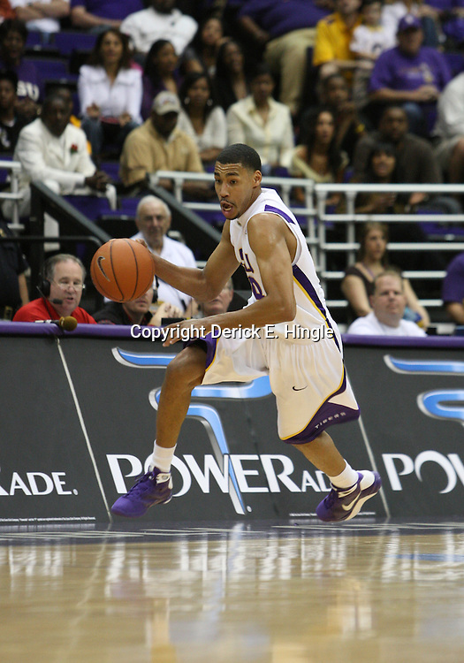 14 February 2009: LSU guard Chris Bass (4) drives down court during a NCAA basketball game between SEC rivals the Ole Miss Rebels and the LSU Tigers at the Pete Maravich Assembly Center in Baton Rouge, LA.