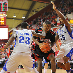 Seton Hall Pirates guard/forward Fuquan Edwin (23) fouls Rutgers Scarlet Knights forward Kadeem Jack (22) during second half Big East NCAA Basketball between the Rutgers Scarlet Knights and Seton Hall Pirates at the Louis Brown Athletic Center. Seton Hall defeated Rutgers 59-55.