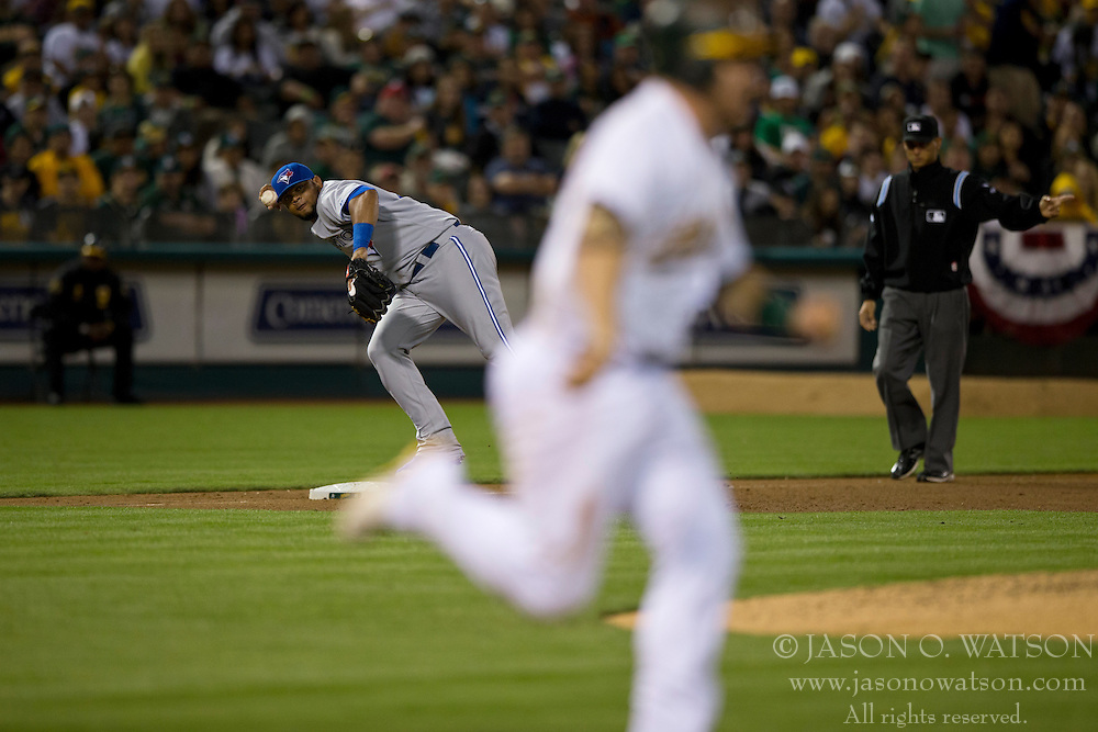 OAKLAND, CA - JULY 05:  Stephen Vogt #21 of the Oakland Athletics beats a throw from Juan Francisco #47 of the Toronto Blue Jays for an infield single during the sixth inning at O.co Coliseum on July 5, 2014 in Oakland, California. The Oakland Athletics defeated the Toronto Blue Jays 5-1.  (Photo by Jason O. Watson/Getty Images) *** Local Caption *** Stephen Vogt; Juan Francisco