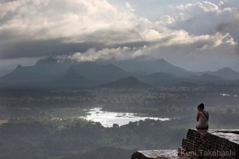 Visitor sits on top of the Lion Rock in Sigiriya, Sri Lanka on January 5, 2016. The ruins of ancient city created in the 5th century A.C by King Kashyapa, who built his palace on top of the rock, become one of the UNESCO World Heritage Site in 1982. (Photo by Kuni Takahashi)