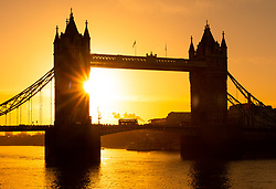 © Licensed to London News Pictures. 22/01/2019. London, UK.  A bus travels across Tower Bridge during sunny and cold weather as commuters make their way to work this morning.  Photo credit: Vickie Flores/LNP