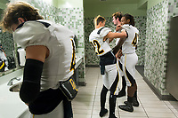 Del Oro Golden Eagles get ready inside the locker room before the game as the Granite Bay Grizzlies host the the Del Oro Golden Eagles in the Sac-Joaquin Section Division II championship game at Hornet Stadium at Sacramento State, Saturday Dec 2, 2017. <br /> photo by Brian Baer