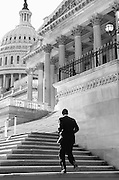 Sen. Obama walks up the steps of the U.S. Capitol en route to the Senate floor for a vote in November 2005...(Photo by Pete Souza)