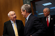 Former Sen. PHIL GRAMM, (R-TX) talks with Senator MAX BAUCUS (D-MT) before he is to testify at a Senate Finance Committee hearing on Budget Enforcement Mechanisms. In 1985 and 1987 Gramm spearheaded the Gramm-Rudman Acts which were a means of cutting the budget through across-the-board spending cuts if deficit-reduction targets were not met. Gramm is vice chairman of UBS Investment Bank.