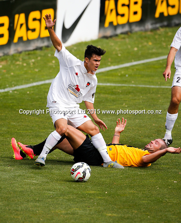 Canterbur's Miles John is tackled by Jarrod Smith. ASB Premiership Football - Wellington v Canterbury, 08 February 2015, , Wellington, New Zealand. Photo: John Cowpland / www.photosport.co.nz