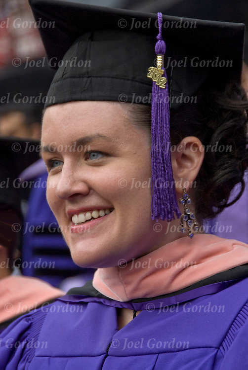 Cristy college graduate in cap and gown, before  receiving her Masters in Public Health from NYU at Yankee Stadium in the Bronx, New York.<br />
