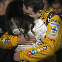NASCAR Sprint Cup driver Kyle Busch hugs Samantha Sarcinella prior to the NASCAR Sprint Unlimited Race at Daytona International Speedway on Saturday, February 16, 2013 in Daytona Beach, Florida.  (AP Photo/Alex Menendez)