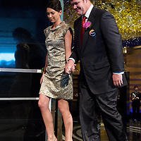 MACAU, CHINA - JUNE 01:  Businessman James Packer and wife Erica Baxter arrive to the opening of Packer and Lawrence Ho's 'City of Dreams' casino on June 1, 2009 in Cotai, Macau. The new 420,000 square foot casino, built on marshland 9km from Macao's traditional casino district but over the road from the world's largest casino 'Sands Venetian Macao', hopes to lure customers to the new casino area. 'City of Dreams' will offer over 500 gambling tables alongside its 3 hotels, a shopping mall and digital fish which swim in an electronic aquarium know as 'The Bubble'.  Photo by Victor Fraile / studioEAST
