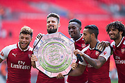 Arsenal forward Danny Welbeck (23), Arsenal midfielder Alex Oxlade-Chamberlain (15), Arsenal forward Olivier Giroud (12), Arsenal forward Theo Walcott (14), Arsenal midfielder Mohamed Elneny (35) celebrate win during the FA Community Shield match between Arsenal and Chelsea at Wembley Stadium, London, England on 6 August 2017. Photo by Sebastian Frej.
