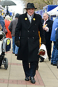 © Licensed to London News Pictures. 21/02/2013. Eastleigh, UK. Business Secretary and Liberal Democrat Vince Cable walks through the local market in Eastleigh holding a bunch of roses  bought from a flower seller whilst campaigning for the  Eastleigh by-election today 21 February 2013. Photo credit : Stephen Simpson/LNP