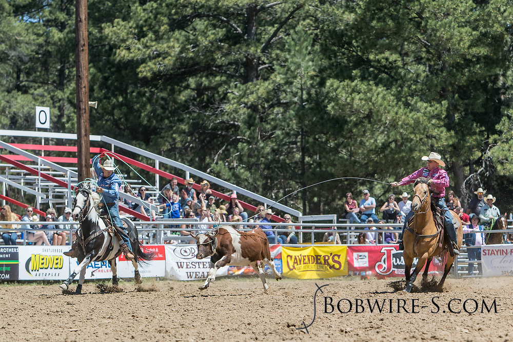 Header JD Yates and heeler Ryon Tittel make their team roping run in the first performance of the Elizabeth Stampede on Saturday, June 2, 2018.