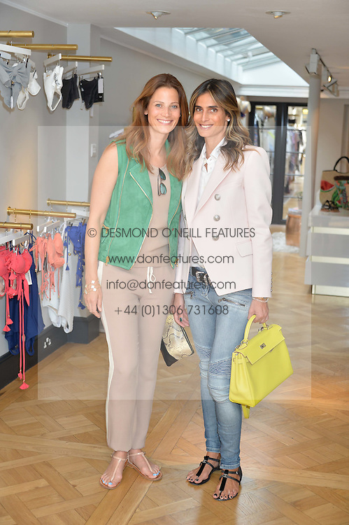 Left to right, JULIA ZAOUK and CLAUDIA RUIMY at the launch of the new Salt store at 91 Walton Street, London on 7th July 2016.