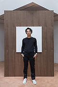 Tokyo, Japan, December 11 2017 - Portrait of the artist Eugene KANGAWA, founder of The Eugene Studio, in his exhibition at Shiseido Gallery in the Ginza area.