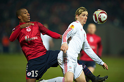 LILLE, FRANCE - Thursday, March 11, 2010: Liverpool's Fernando Torres and LOSC Lille Metropole's Emerson during the UEFA Europa League Round of 16 1st Leg match at the Stadium Lille-Metropole. (Photo by David Rawcliffe/Propaganda)