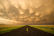A huge summer thunderstorm rolls out of the Rockies and dumps large amounts of rain and hail in the plains of eastern New Mexico. This photo depicts the isolation of people in eastern New Mexico.