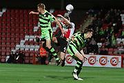 Mark Roberts gets a kick from Kyle  during the EFL Trophy match between Cheltenham Town and Forest Green Rovers at Whaddon Road, Cheltenham, England on 3 October 2017. Photo by Antony Thompson.