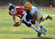 Central Bucks East quarterback Evan O'Donnell (7) is sacked by Central Bucks West's Spencer Piligian (78) in the first quarter Saturday, October 21, 2017 at Central Bucks East in Buckingham, Pennsylvania. (Photo by William Thomas Cain)