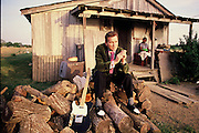 Billy Lee Riley, in front of a share croppers shack in Memphis, Tennessee. Billy was sitting for an album cover.